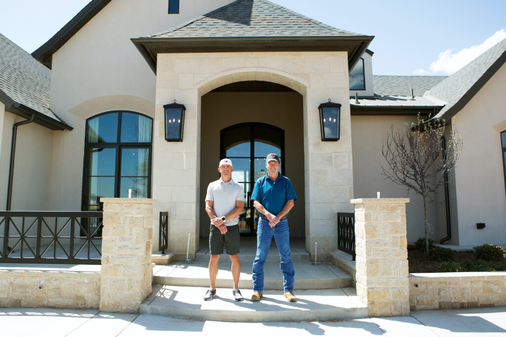 Owners Mike & Lucas standing in front of a custom build